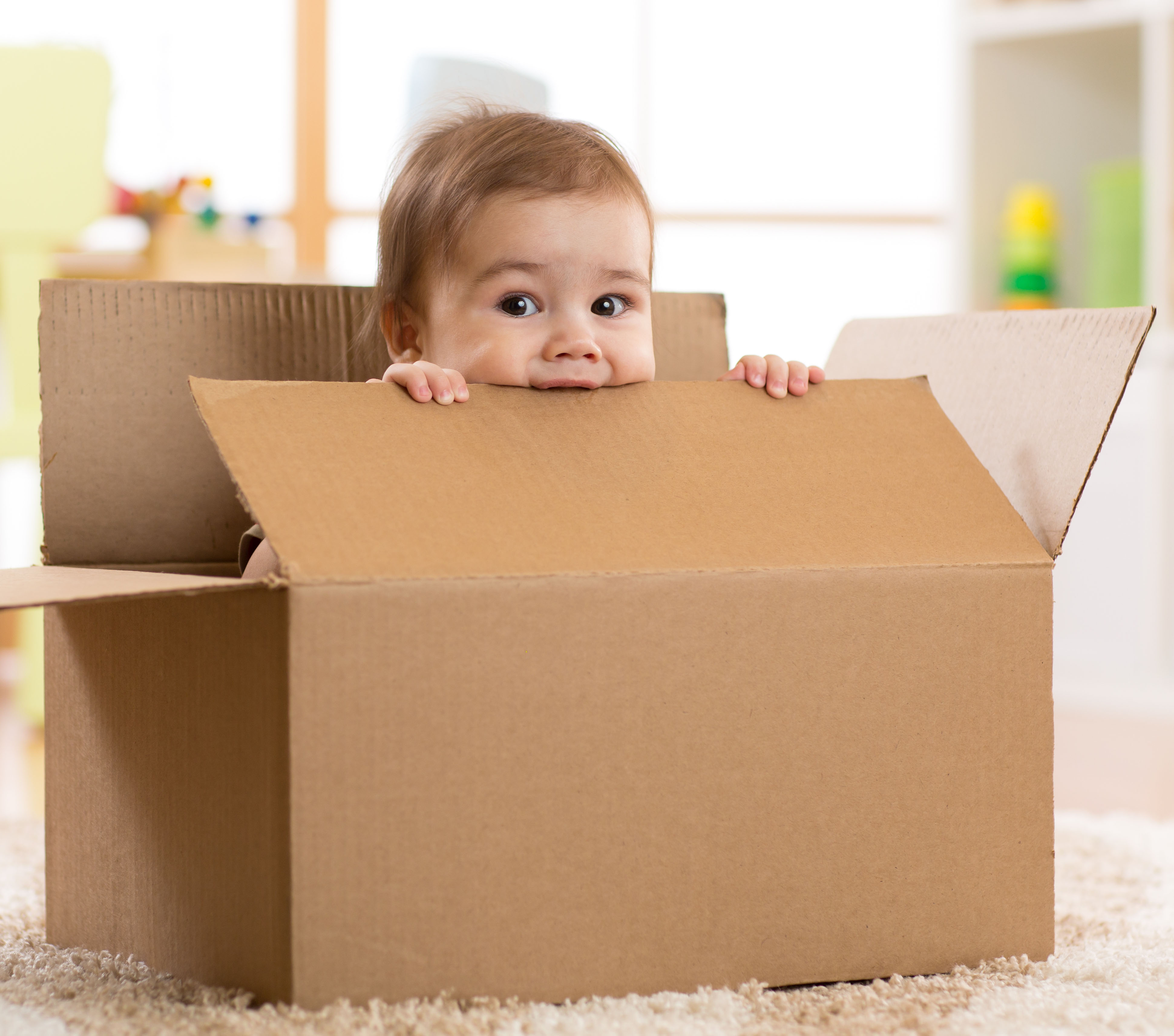 Baby in Shipping Box