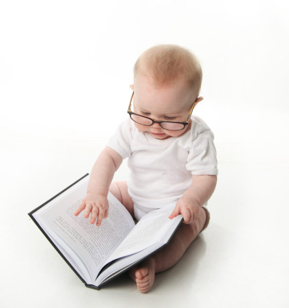 Baby Reading in Glasses