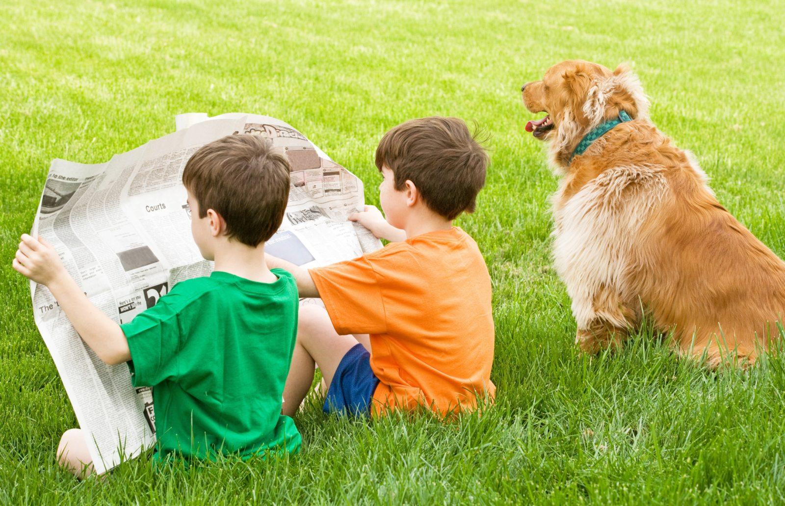 Newspaper Kids and Dog