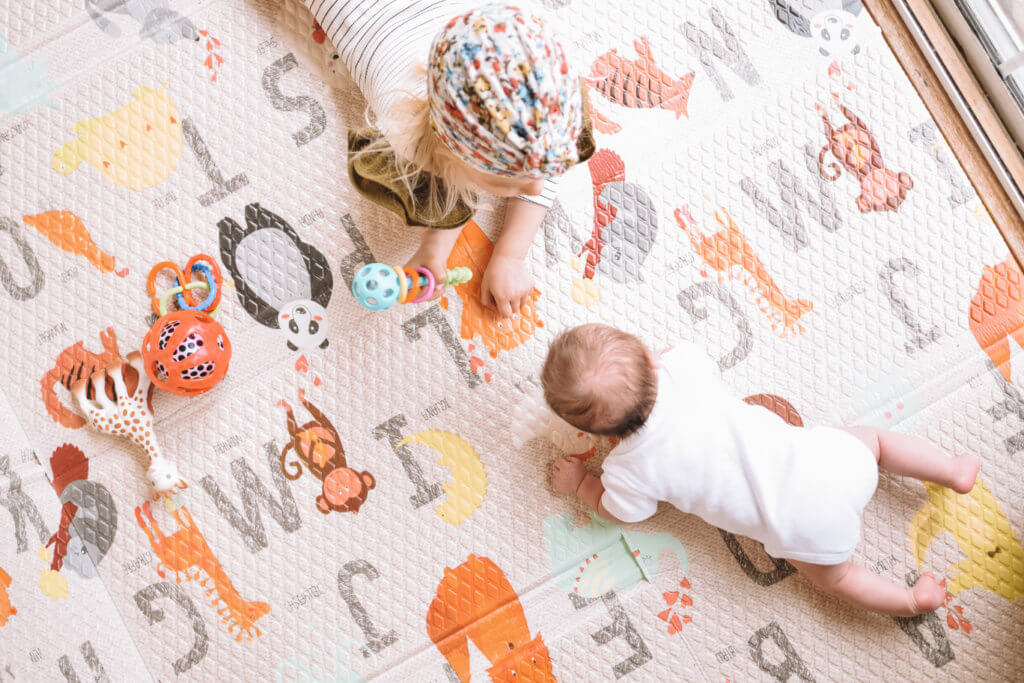 Crawling baby on ABC playmat